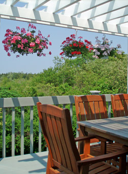 Enjoy breakfast on the deck at the High Pointe Inn Bed and Breakfast on Cape Cod