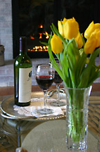 Enjoy a glass of wine by the fire at the High Pointe Inn Bed and Breakfast on Cape Cod